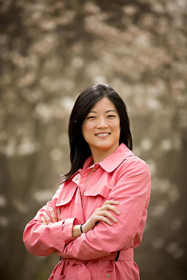 black haired woman in pink shirt