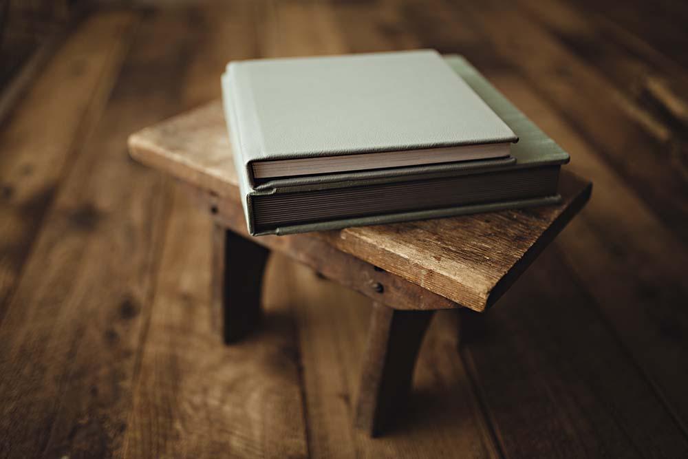 green books on stool