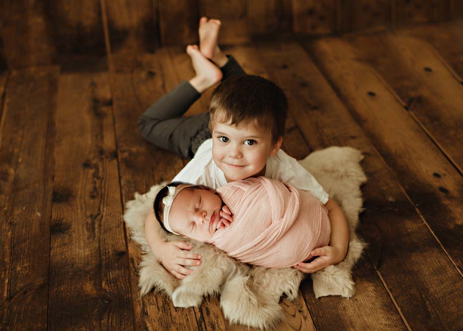 newborn with boy