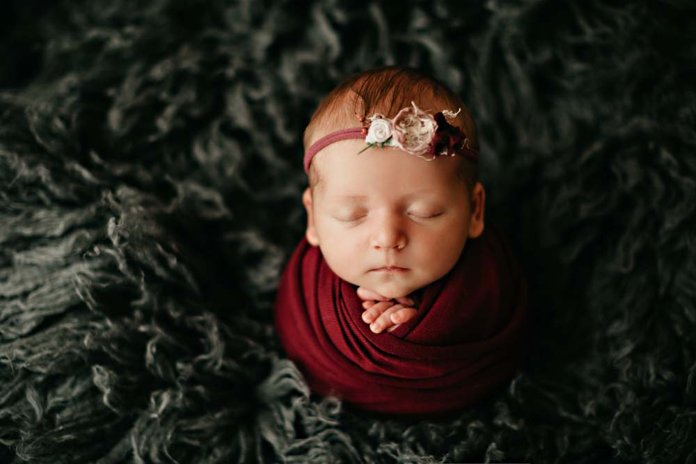 newborn in red