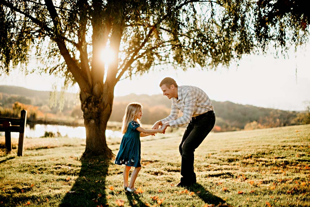 dad and girl and tree