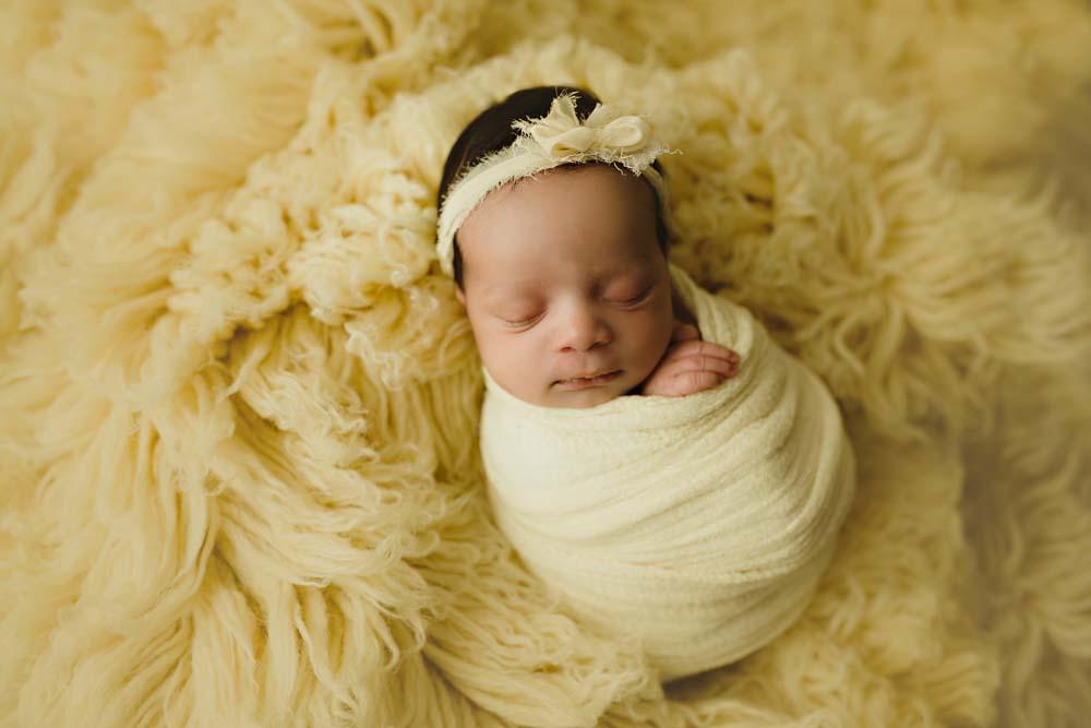 newborn in yellow