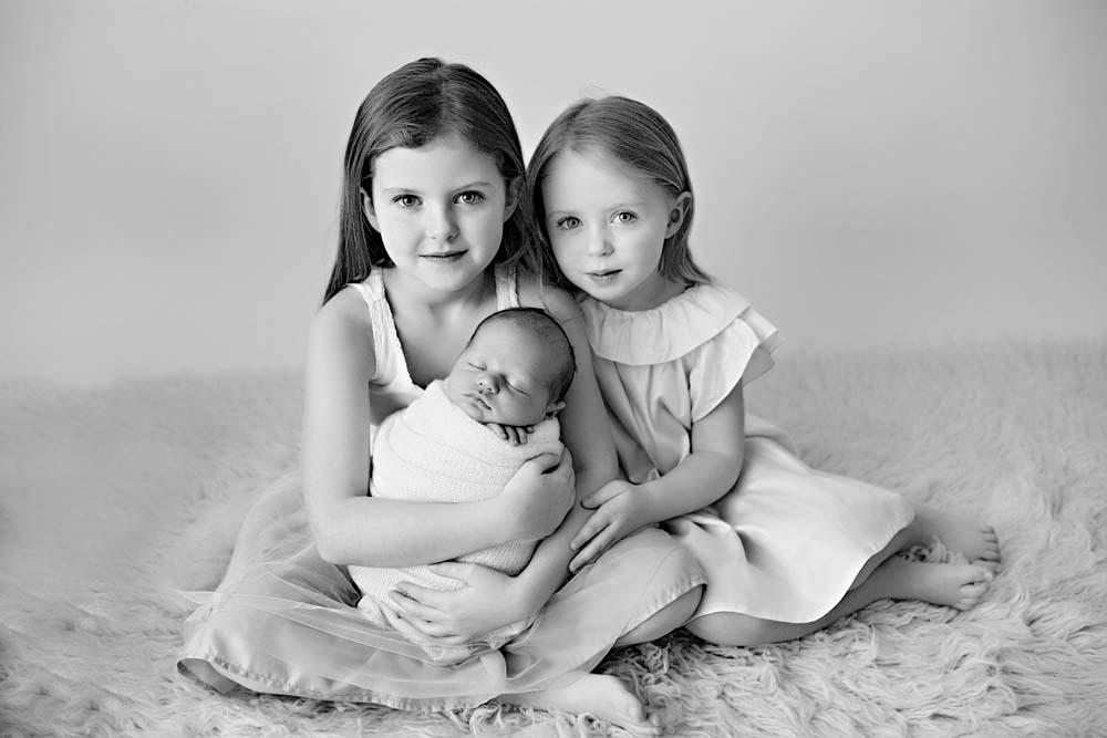 bw newborn with girls